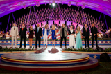 (L to R) Gerald McRaney, Anthony Kearns, Danielle Bradbery, Colin Powell, Jennifer Nettles, Megan Hilty, Caleb Johnson, Dianne Wiest, Jackie Evancho, Gary Sinise and Joe Mantegna onstage at the 25th annual National Memorial Day Concert finale on the West Lawn of the U.S. Capitol, May 25, 2014, in Washington, DC.