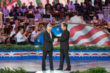 Co-Hosts Gary Sinise and Joe Mantegna greet each other on stage during the 2015 National Memorial Day Concert.