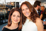 Music icon Gloria Estefan and Broadway star Laura Benanti pose backstage during the 2015 National Memorial Day Concert.