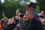 Actor Laurence Fishburne sits in the audience with honoree Ted Strong during the 2015 National Memorial Day Concert.