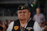 A Yakama Warrior veteran stands as Vietnam veterans are honored on the 27th <em>National Memorial Day Concert</em>.