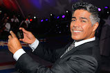 "Actor Esai Morales takes a ""selfie"" onstage at the 27th <em>National Memorial Day Concert</em> on May 29, 2016 in Washington, DC."
