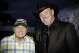 Bruce Johnston of The Beach Boys and country music star Trace Adkins take a photo backstage at the 2016 <em>National Memorial Day Concert</em>.