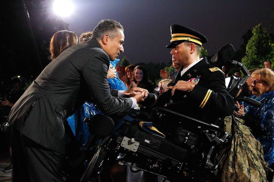 Actor John Ortiz greets Army Capt. Luis Avila at PBS' 2017 <em>National Memorial Day Concert</em> at U.S. Capitol, West Lawn on May 28, 2017 in Washington, DC. Avila survived a near-fatal bomb attack while on a tour of duty in Iraq. (Photo by Paul Morigi/Getty Images for Capital Concerts)