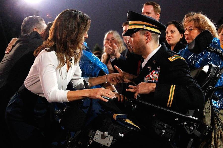 Actress Ana Ortiz greets Army Capt. Luis Avila at PBS' 2017 <em>National Memorial Day Concert</em> at U.S. Capitol, West Lawn on May 28, 2017 in Washington, DC. Avila survived a near-fatal bomb attack while on a tour of duty in Iraq. (Photo by Paul Morigi/Getty Images for Capital Concerts)