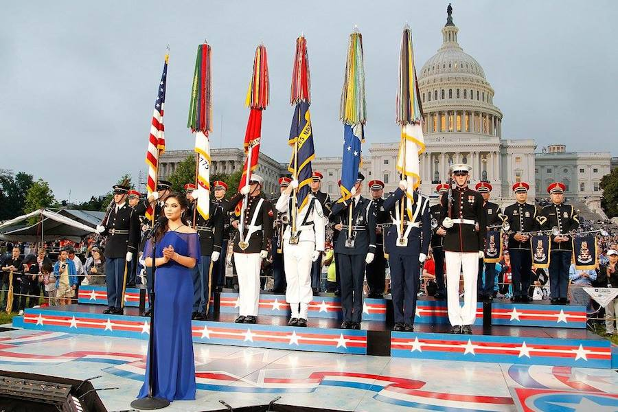 "Auli'i Cravalho of the hit Disney film ""Moana"" performs the ""U.S. National Anthem"" at PBS' 2017 <em>National Memorial Day Concert</em> at U.S. Capitol, West Lawn on May 28, 2017 in Washington, DC. (Photo by Paul Morigi/Getty Images for Capital Concerts)"