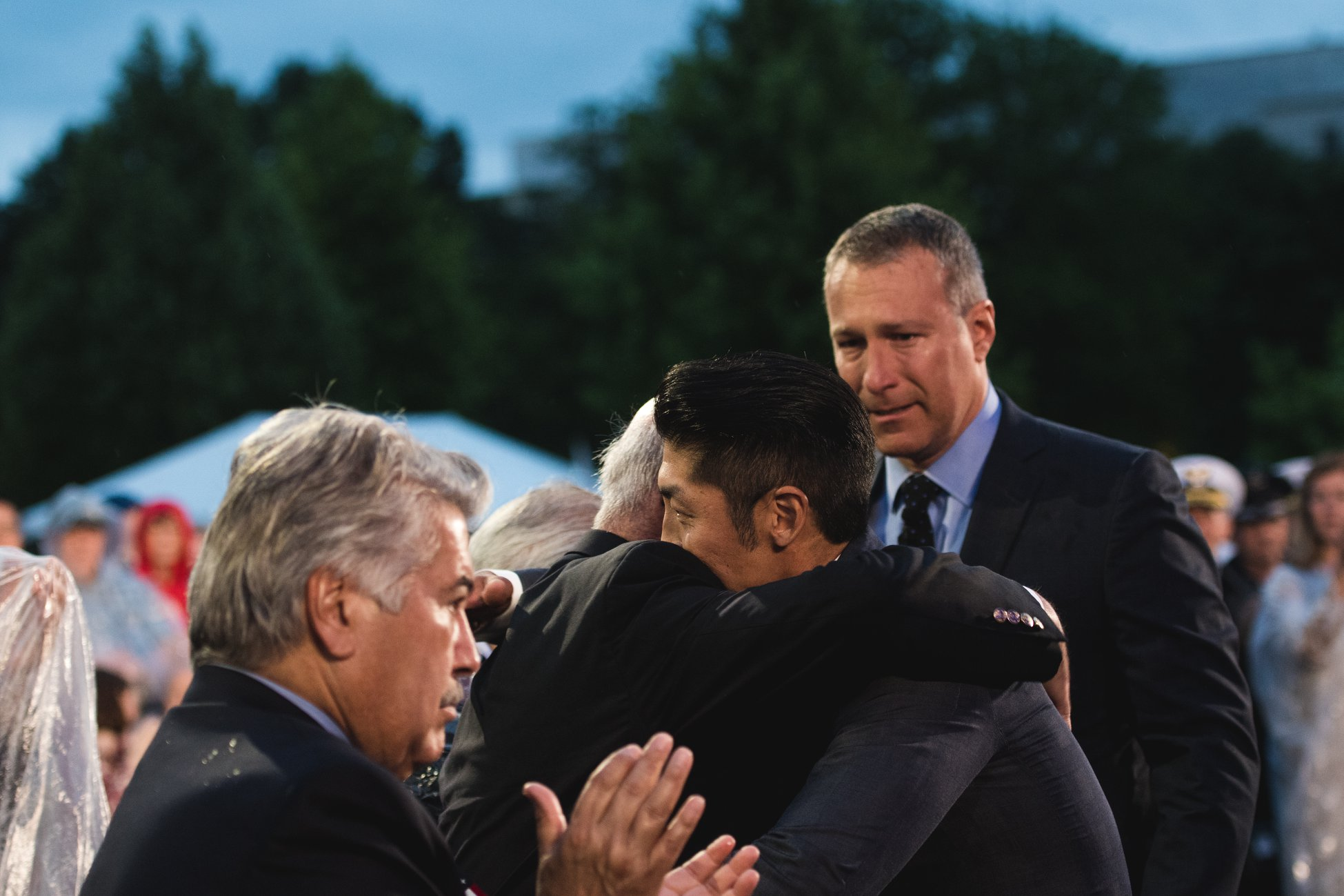 "Actors Brian Tee and John Corbett greet Korean War veterans Hiroshi ""Hershey"" Miyamura and Joe Annello after sharing their story at the 2018 <em>National Memorial Day Concert</em>."