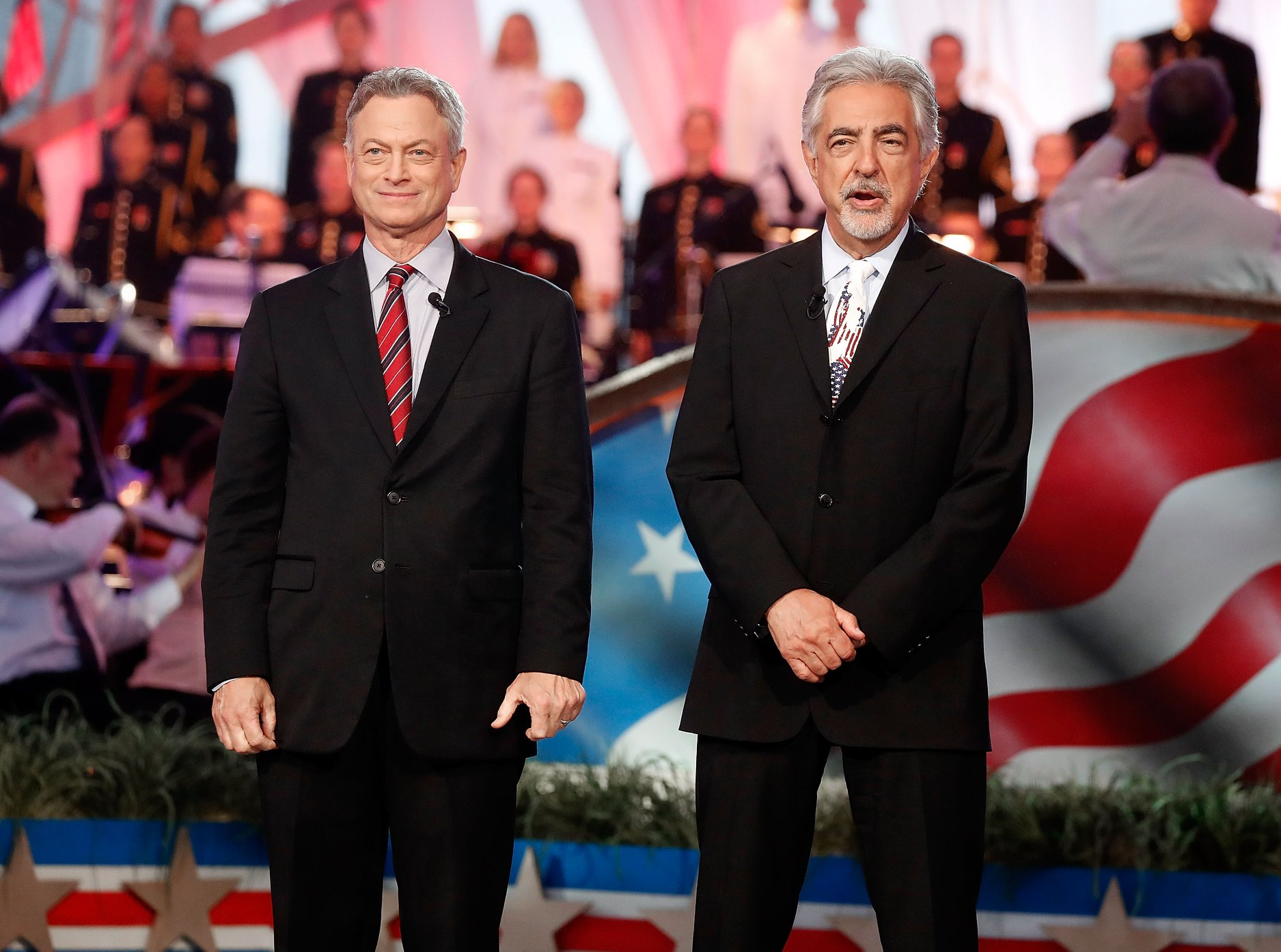 Actors and co-hosts Gary Sinise and Joe Mantegna onstage at the 2018 <em>National Memorial Day Concert</em>.