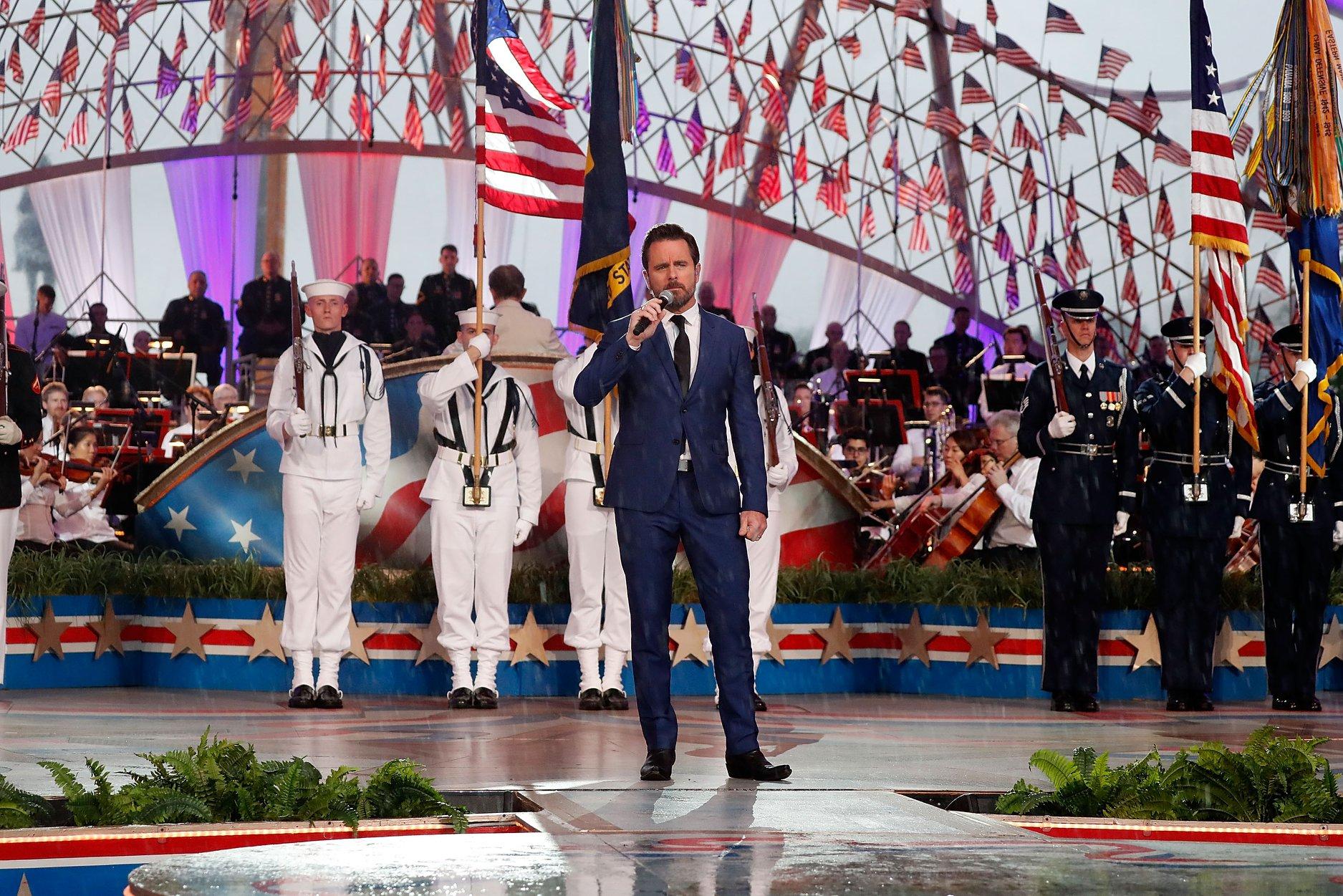 """Singer Charles Esten performing """"Some Gave All"""" at the 2018 <em>National Memorial Day Concert</em>."""