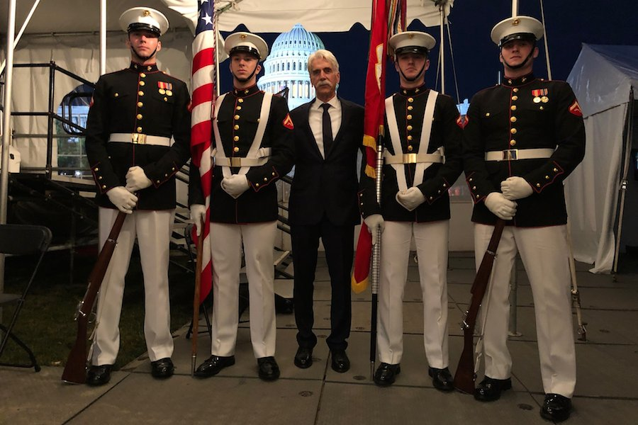 Actor Sam Elliott backstage with the United States Marine Corps Color Guard for the 2019 <em>National Memorial Day Concert</em> rehearsal.