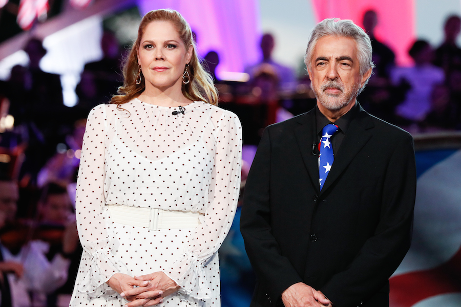 Actors and Co-hosts Mary McCormack and Joe Mantegna onstage at the 2019 <em>National Memorial Day Concert</em>.