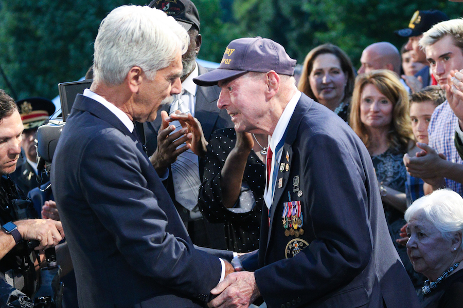 Actor Sam Elliott greets D-Day veteran SGT Ray Lambert after telling his story at the 2019 <em>National Memorial Day Concert</em>.