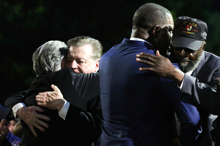 "Actors Dennis Haysbert and Joe Mantegna greet Vietnam War veterans Ernest ""Pete"" Peterson and Brad Kennedy after sharing their story at the 2019 <em>National Memorial Day Concert</em>."