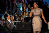 Katherine McPhee and Lang Lang perform <i>America the Beautiful</i> on the 2009 <i>National Memorial Day Concert</i>.