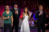 Chris Daughtry, Trace Adkins, Jessica Sanchez, and Russell Watson perform <i>God Bless America</i> on the 2012 <i>National Memorial Day Concert</i>.