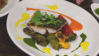 Pan-Seared Rockfish with Roasted Pepper Medley and Three Pepper Gastrique
