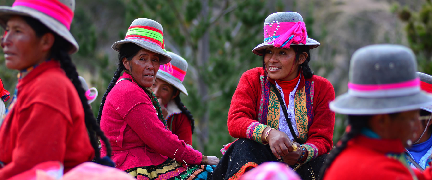 Peruvian mountain villagers dressed in bright clothing