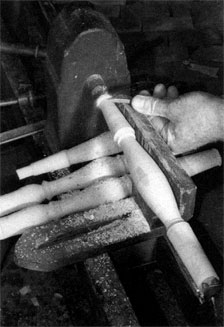 Begin by turning the spindles so that they will be thoroughly dry (and fully shrunk) by the time y ou join them to the rest of the chair.