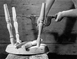 Drive the legs into place, and bore between them to make the holes to take the side stretchers.
