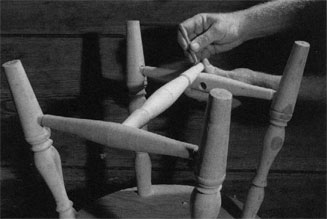Set in the side stretchers and bore between them to insert the middle stretcher.