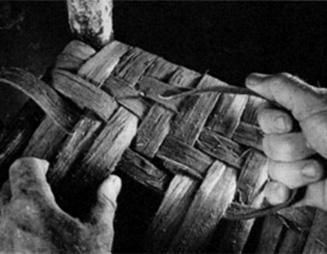 The bottom warped and the weave begun, Four alternating starts create the herringbone pattern.