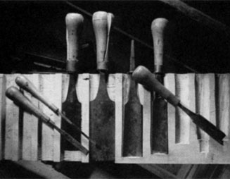The surviving chisels and gouges resting in their partially disassembled rack.