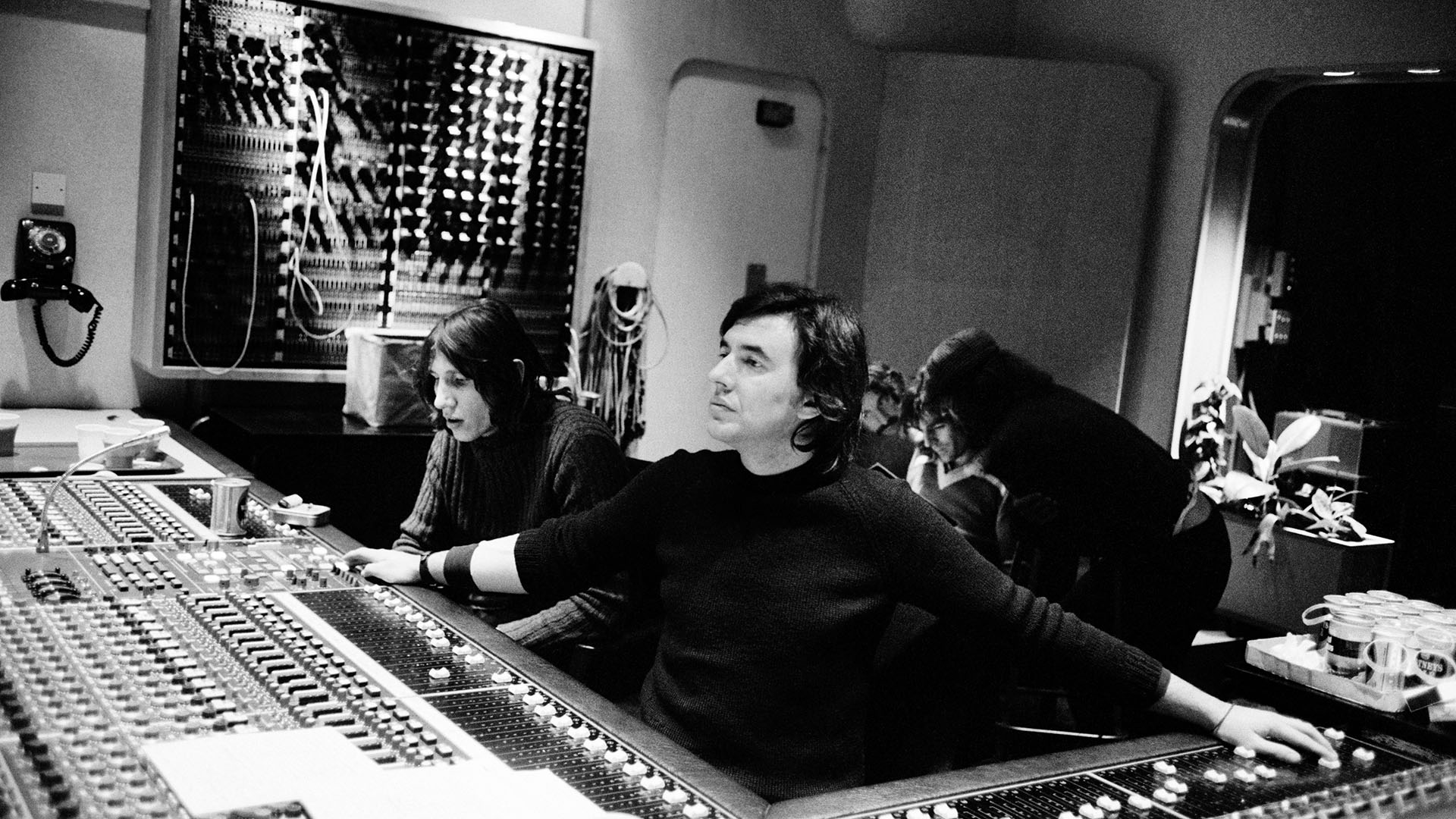 Roger Waters of Pink Floyd, left, sits in the producer control room in 1974.