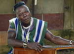 "Borbor ""Bobby"" Sakpa plays a song about the troubles Ebola has brought on the town of Kailahun in Sierra Leone."