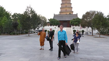 Michael Wood, Buddhist monk and film crew in front of Wild Goose Pagoda