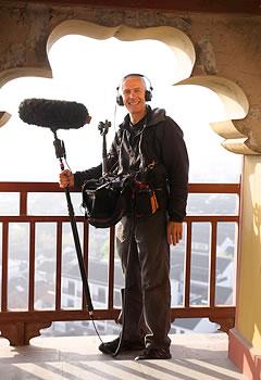 crew member holding boom mic