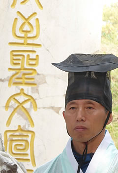 Man wearing ceremonial clothing