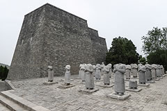 rows of statues of people without heads