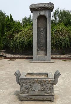 Stone square urn and small monument with Chinese writing