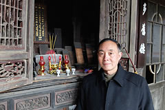 man standing in front of wooden alter