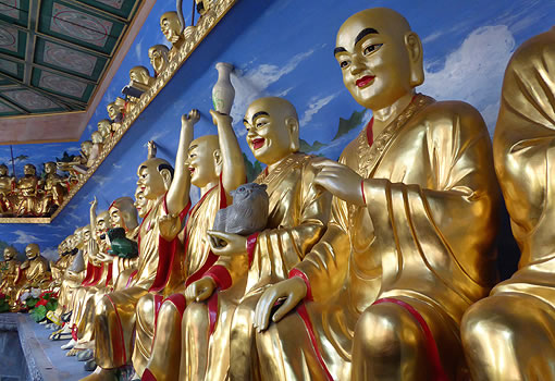 colorful Buddhist statues in various poses