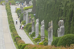 stone statues along a road
