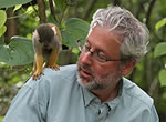 Neil Shubin gets up close and personal with a tiny squirrel monkey at Monkey Jungle in Miami, Fla.