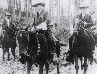 Calvin Coolidge riding a horse to Mount Rushmore
