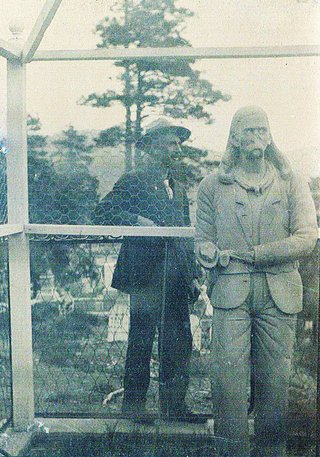 Charles Robinson with statue of Wild Bill