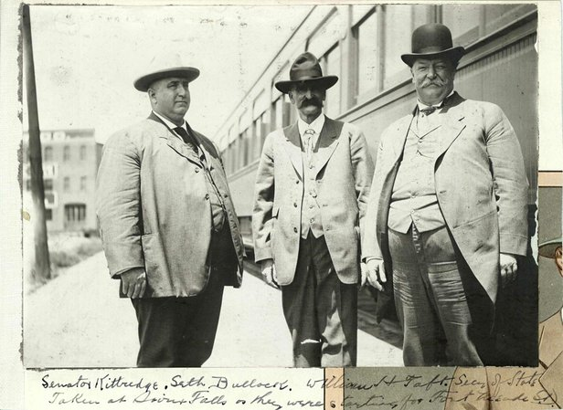 Bullock stands with William Howard Taft at the train station in Sioux Falls.