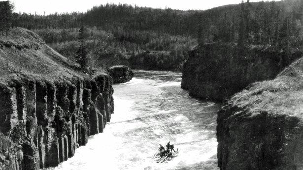 Klondikers on raft navigating Miles Canyon on the Yukon River, 1898.