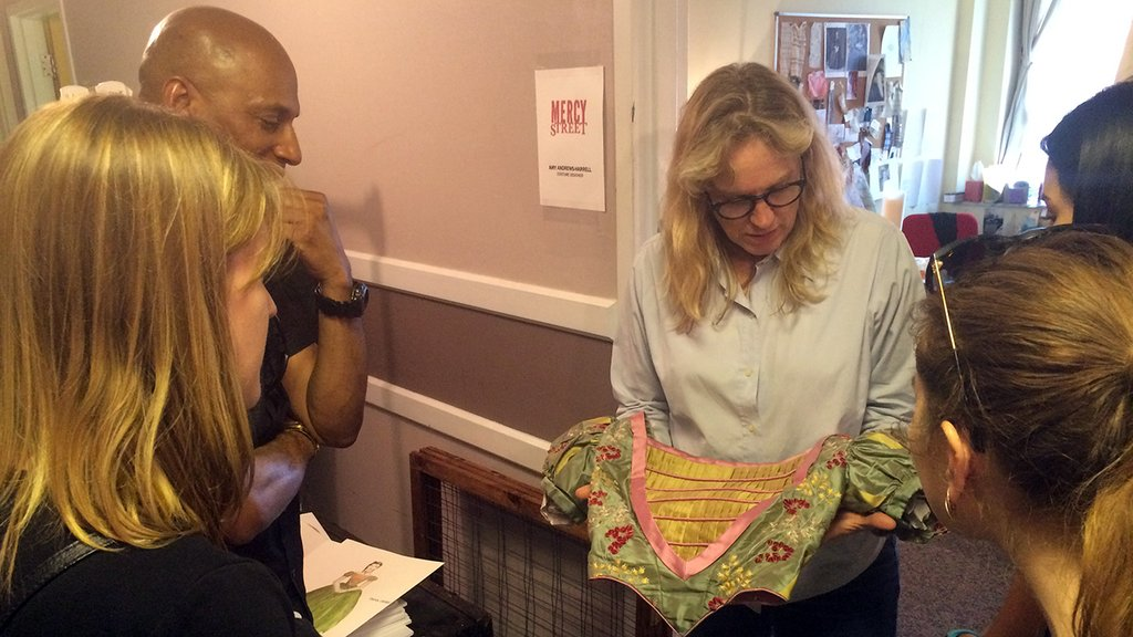 PBS staff set visit winners learn about Mercy Street's costumes