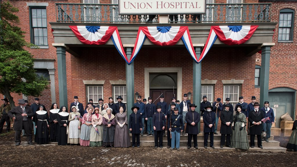 Staff, volunteers and Union soldiers at Mansion House Hospital, as seen in Episode 6