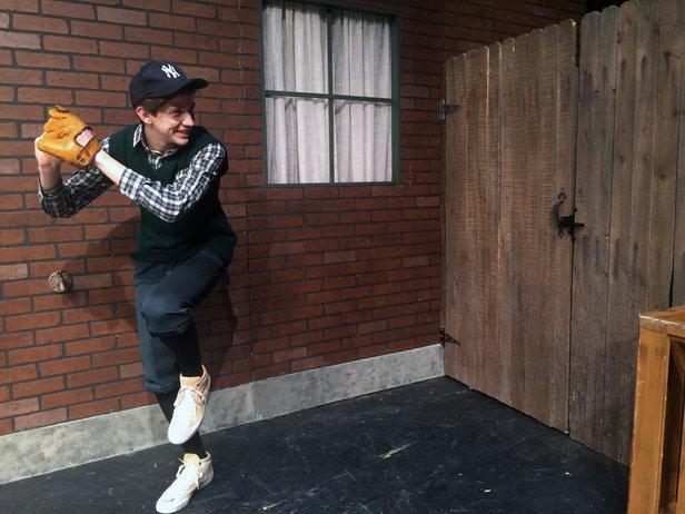 "Eugene (Ethan Worsham) practices pitching in ""Brighton Beach Memoirs."""