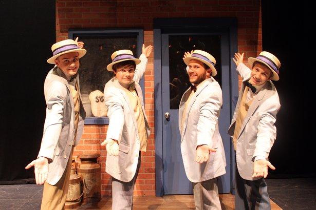 "Kayden Burns, from left, Alex Nair, Brandon Wilhelm and Ethan Worsham sing as a barbershop quartet in ""The Music Man."""