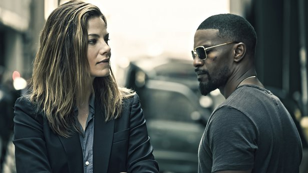 "Michelle Monaghan and Jamie Foxx star in ""Sleepless."""