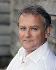Hugh Bonneville plays Robert, Earl of Grantham, in Downton Abbey.