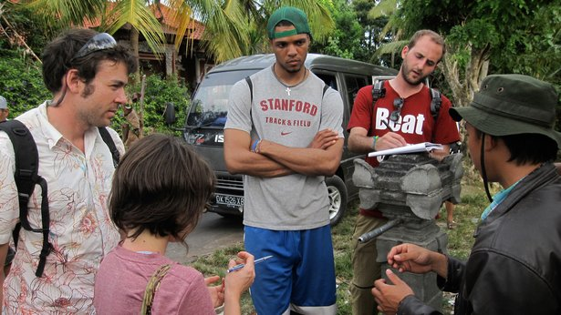 Durell (center, in Stanford t-shirt) and his teammates struggle to understand water-delivery problems in an Indonesian village.