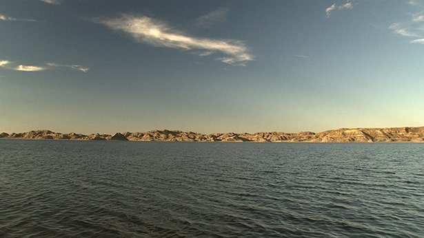 Fort Peck Lake is 134 miles upstream of the dam, storing over 18 million acre feet of water.