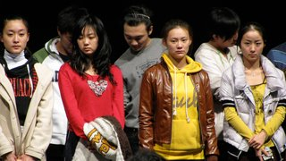 Students in the first Chinese staging of the American musical Fame being scolded.